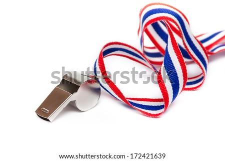 Metal whistle isolated on white - stock photo