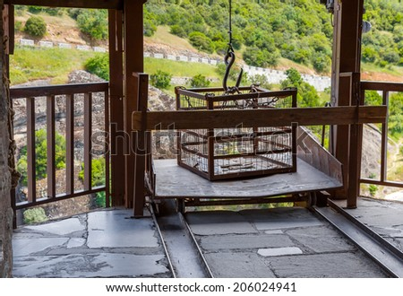 Metal winch and cage for packets transfer in Varlaam monastery, Meteora, Kalambaka, Greece - stock photo