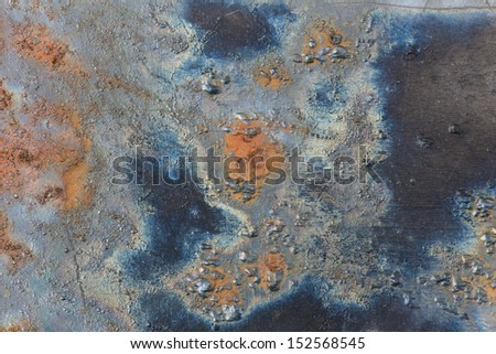 metal with blue and orange rust