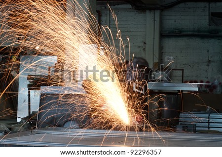 Metal worker grinding in a steel factory