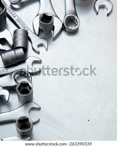 Metal working tools. Metal style. Wrenches on the scratched metal background. - stock photo