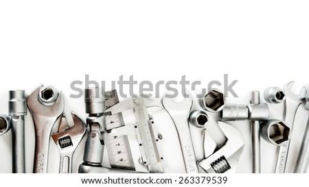 Metal working tools. Metalwork. Spanner , ruler, caliper and others tools on white background. - stock photo