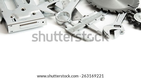 Metal working tools. Metalwork. Stapler, saw, wrench and others tools on white background.