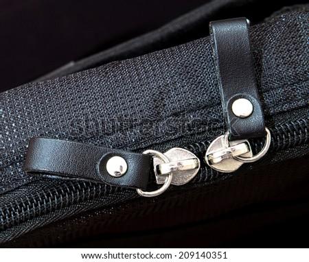 Metal zipper on black synthetic fabric  - stock photo