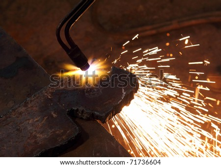 metall detail cutting with acetylene welding close-up - stock photo