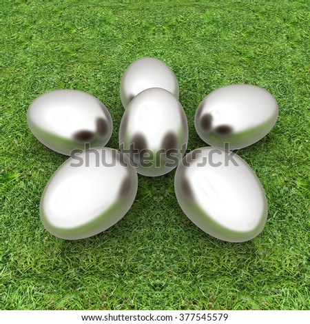 Metall Easter eggs as a flower on a green grass