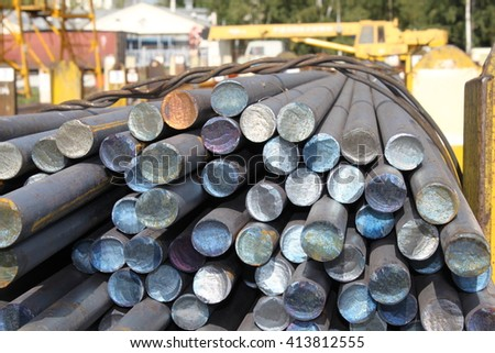 Metall rolled bar. Steel round. Carbon bar. Hot rolled ferrum. Rounded metal. Circle bar. - stock photo