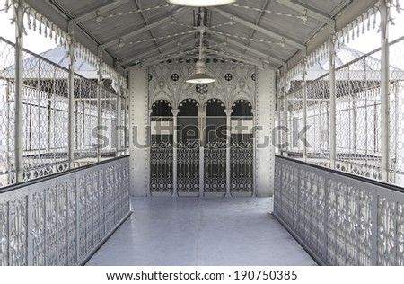 Metallic and deep corridor, detail of a hall with elevator to the background, old - stock photo