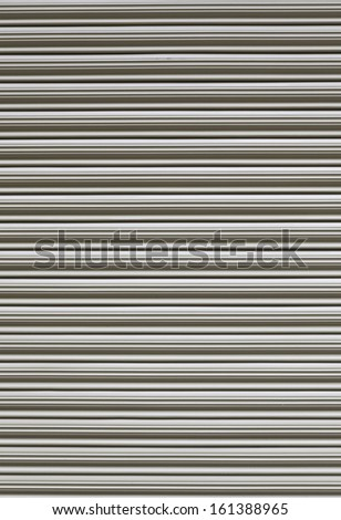 Metallic background of a doorway, detail of a metal door in a house, closed and protection and security