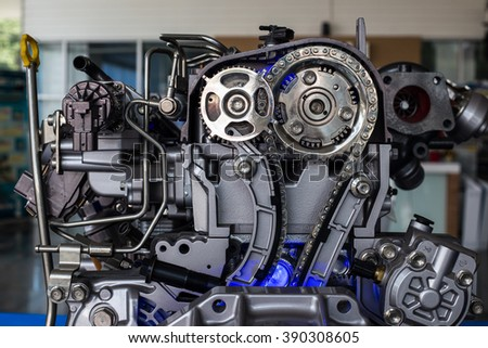 Metallic background of the internal combustion engine. - stock photo