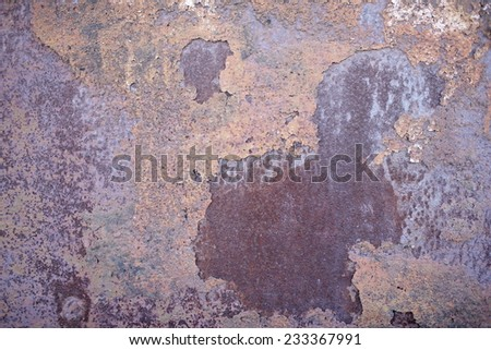 metallic background with cracked paint and rusty iron