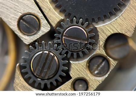 Metallic Background with metal cogwheels a clockwork. Macro - stock photo