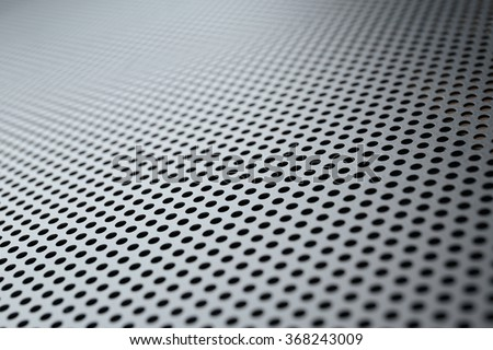 Metallic background with perforation of round holes - stock photo