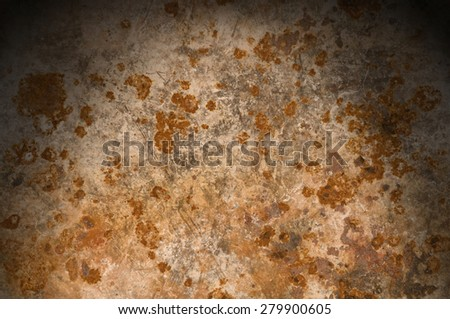Metallic background with rusty corrosion lit from above - stock photo
