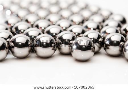 ball bearing balls. metallic bearing balls on white background ball