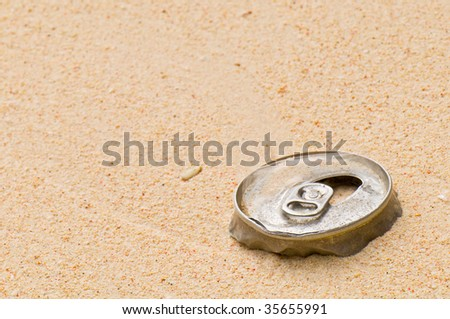 Metallic Can on a Beach Pollution Abstract - stock photo