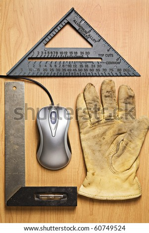 Metallic computer mouse and old tools placed to resemble a house - stock photo