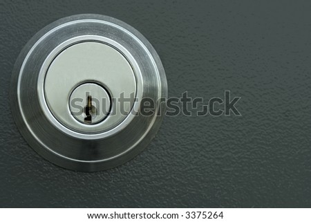 Metallic door lock and keyhole - stock photo