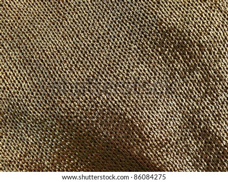Metallic elegant crochet fabric close up. - stock photo