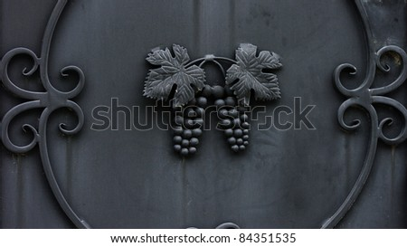 Metallic grape leaves and cluster ornaments - stock photo