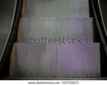 Metallic gray escalator stair cases - stock photo