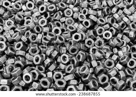Metallic medium small size bolts pattern and background  - stock photo