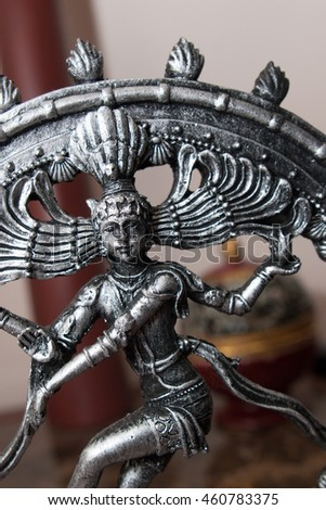 metallic miniature statue of hinduism god Krishna
