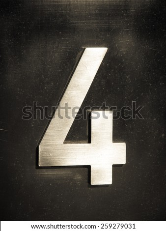 metallic number four  - stock photo