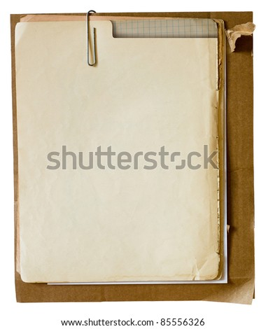 Metallic paper clip on stack of old papers. Clipping path included - stock photo