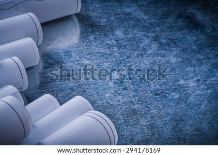 Metallic scratched surface with set of construction drawings copy space image building and architecture concept. - stock photo