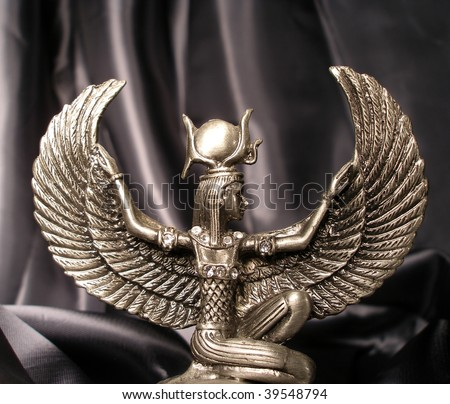 Metallic statuette of the winged goddess of love - stock photo