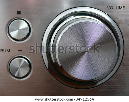 metallic volume handle and round control buttons