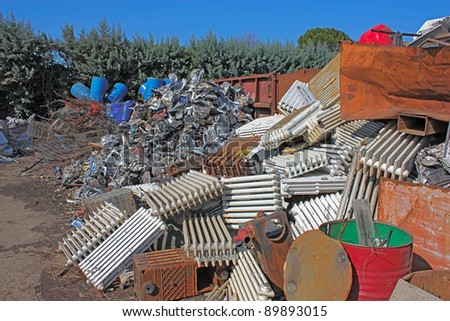 metallic waste storage for recycling - old heating radiators of cast iron and other metals refuse - stock photo