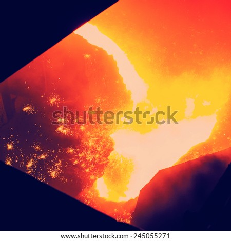 Metallurgical Plant and Technology of production of iron. Molten iron is hot. - stock photo