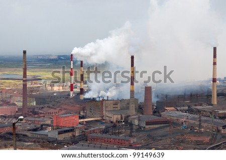 Metallurgical plant polluting the atmosphere with sulfur dioxide. Metallurgical plant of nickel, one of the oldest, built in the thirties of last century. - stock photo