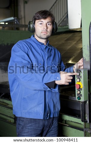 Metalworker pushing the button - stock photo