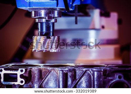 Metalworking CNC milling machine. Cutting metal modern processing technology. - stock photo