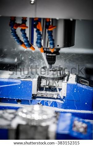 Metalworking CNC milling machine. Cutting metal modern processing technology. - stock photo