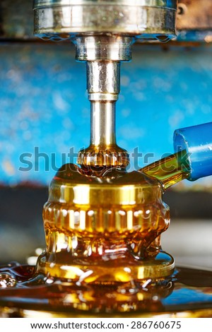 metalworking industry: tooth gear wheel machining by pinion shaped cutter mill tool - stock photo