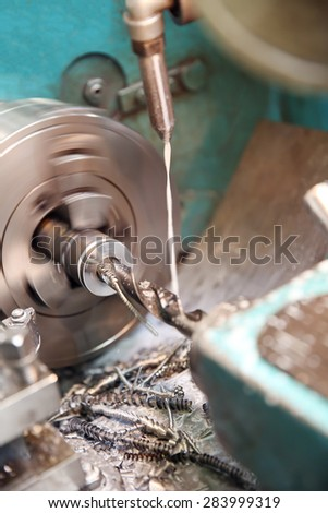 metalworking industry: workpiece drilling on a lathe machine - stock photo