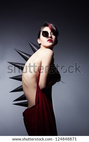 metamorphosis of a young beautiful woman on dark background - stock photo