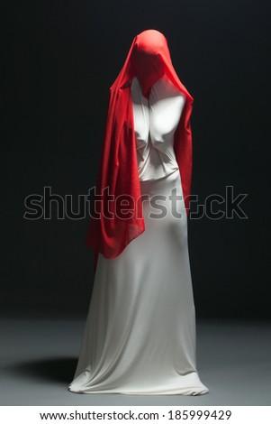 Metaphor for loneliness - faceless female dancer - stock photo