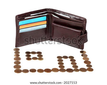 metaphor ofmortgage - brown wallet with cards and coins arranged on house isolated on white background - stock photo