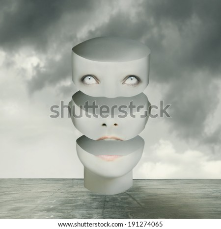Metaphysics imagine representing an human head divided in three parts in a surreal background - stock photo