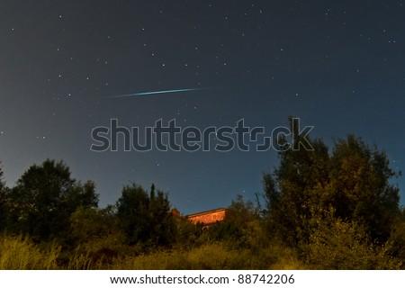 Meteor crossing the sky - stock photo