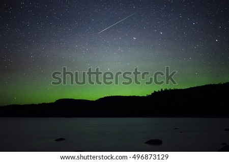 Meteor over the northern lights and Lake superior