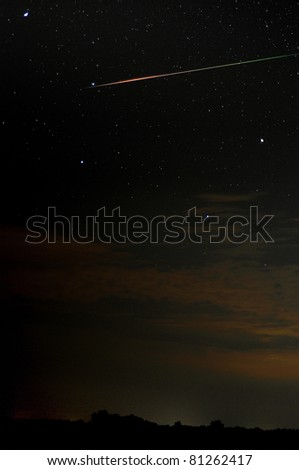 Meteor passing through the Big Dipper - stock photo