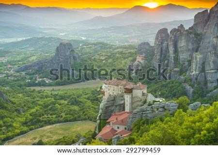 Meteora monasteries at sunset, Greece - stock photo