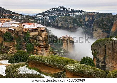 Meteora monasteries in fog. Varlaam and Roussanou monasteries - stock photo