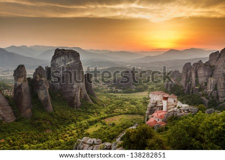 Meteora Roussanou Monastery at sunset, Greece - stock photo